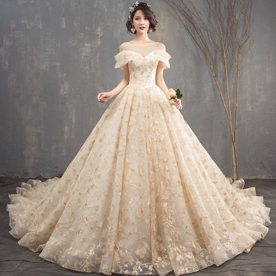 chic-beautiful-champagne-see-through-wedding-dresses-2018-a-line-princess-scoop-neck-short-sleeve-backless-appliques-lace-glitter-sequins-cathedral-train-ruffle-560x560.jpg